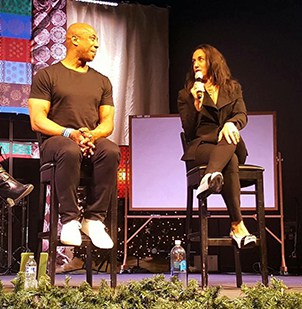 Dr. Cali Estes speaks at the Navigating your Addiction Summit with Former Bronco's player (#82) Vance Johnson.